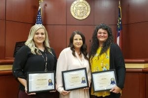 From left to right, Lyndsay Hightower, Tracy Teague, and Jana Grno receive their state certificates in Gilmer's Probate Office.